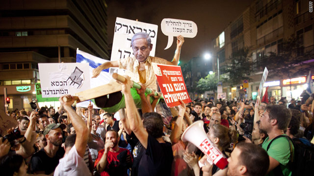 Protesters  in Tel Aviv, Israel,  mock Prime Minister Benjamin Netanyahu during a protest against rising prices on July 30.