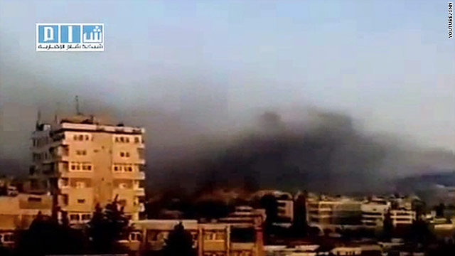 Smoke over Hama, Syria, Sunday: the Syrian military opened fire on the flashpoint city of Hama on Monday.