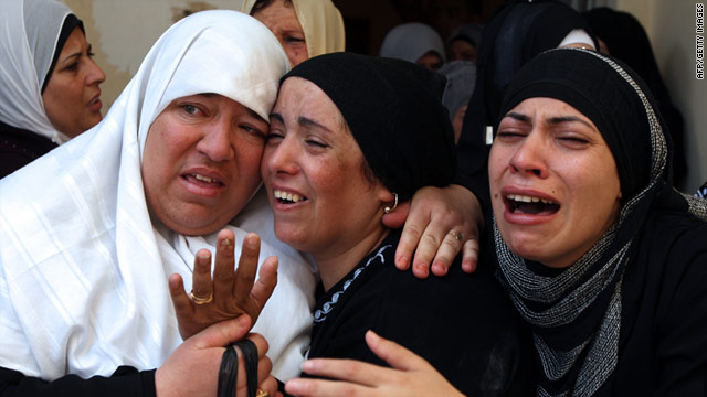 Relatives mourn the death of a Palestinian man after two Palestinians were allegedly shot at the Kalandia refugee camp.