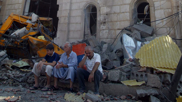 Iraqis sit outside the Holy Family church in the north of Kirkuk after a car bomb exploded wounding at least 20 people.