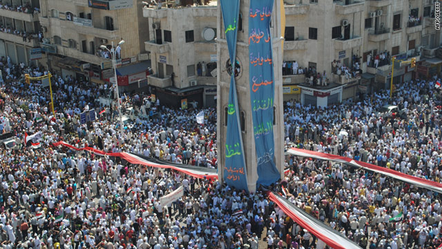 Thousands of Syrians demonstrate against the government after Friday prayers in the besieged city of Hama on July 29, 2011.
