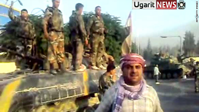A YouTube image grab on July 31 shows what anti-regime protesters say are defected soldiers standing on tanks in Hama.