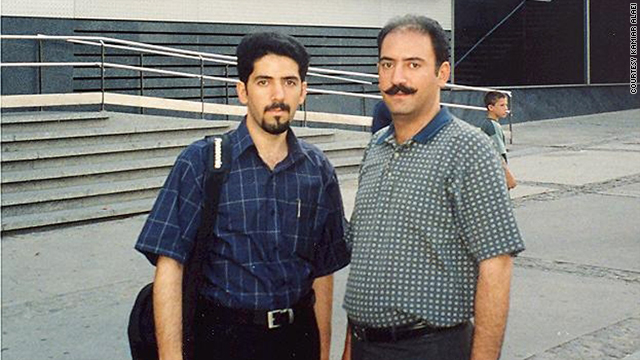 Dr. Kamiar Alaei, left, and his brother, Dr. Arash Alaei, attend the International AIDS Conference in 2002.