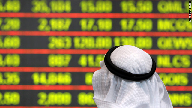A Qatari investor follows stock market activity at the Doha Securities Market