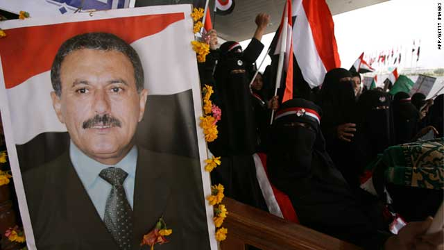 Yemeni men and children hold up portraits of President Ali Abdullah Saleh during a pro-regime rally in Sanaa on July 1, 2011.