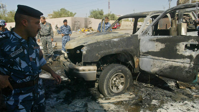 Iraqi security forces inspect a site after an explosion in the northern city of Kirkuk after a series of bomb attacks across Iraq.