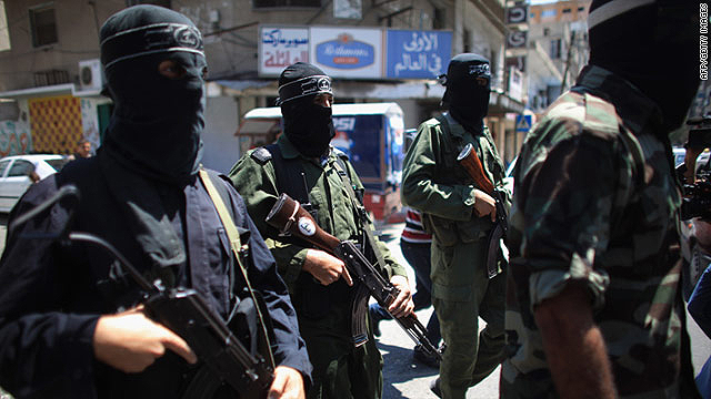 Militants from the Popular Resistance Committee announce a temporary halt to rocket fire into Israel on August 22 in Gaza City.