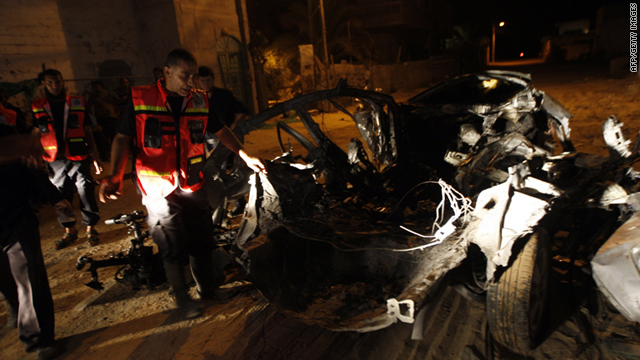 Palestinian security inspects a car damaged in an Israeli air strike in the southern Gaza town of Rafah on Wednesday.