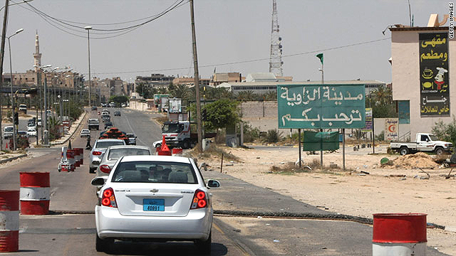 Cars queue to enter Zawiya on June 15. The Italian journalists were traveling from the town towards Tripoli when kidnapped.