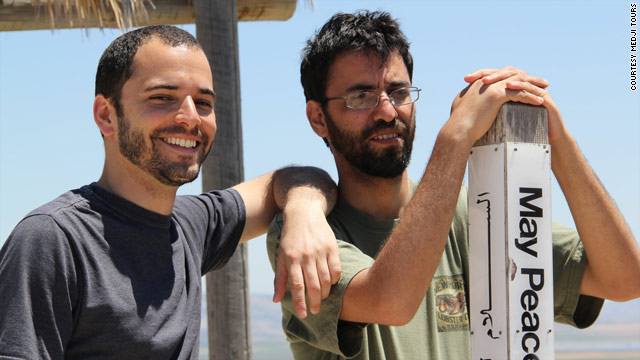 Kobi Skolnick (L), brought up as an ultra-orthodox Jew, and Palestinian Aziz Abu Sarah now run tours together. Ten years ago Skolnik, then an Israeli soldier, fired shots at Abu Sarah's aunt's house in Hebron.