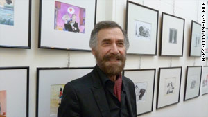 Ali Farzat poses in front of a Damascus exhibition of his cartoon paintings in October 2010.