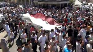 An image grab taken from YouTube shows Syrian anti-government demonstrators in Idlib on August 26, 2011.