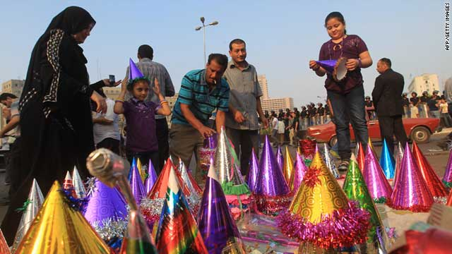 An Egyptian family celebrates the beginning of Eid al-Fitr in Tahrir Square, Cairo, on Tuesday.