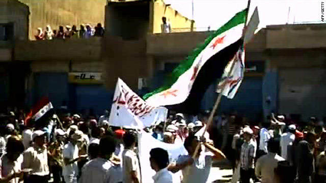 A video on YouTube shows Syrian anti-government demonstrators waving a flag in Qamishli on 26 August.