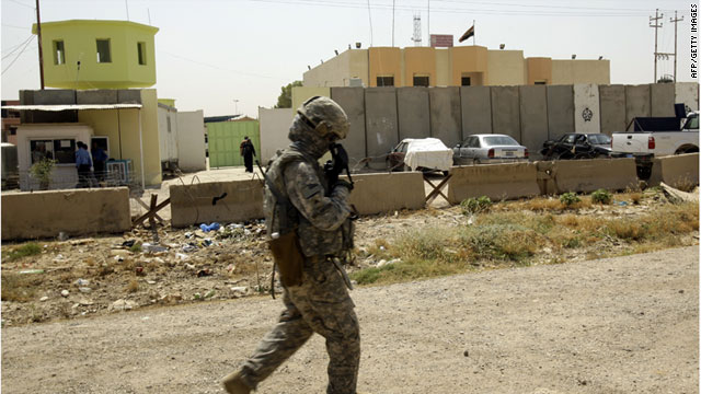 A U.S. soldier patrols recently in Kirkuk, Iraq. Between 46,000 and 50,000 U.S. troops are in Iraq for support and training.