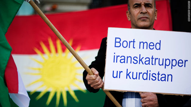 A Kurdish man holds a banner reading 'Iranian troops out of Kurdistan' during a protest in Sweden on September 3, 2011.