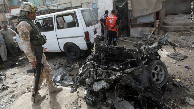 An Iraqi soldier inspects the scene of a bomb blast in the north Baghdad district of Sadr City on May 22, 2011.