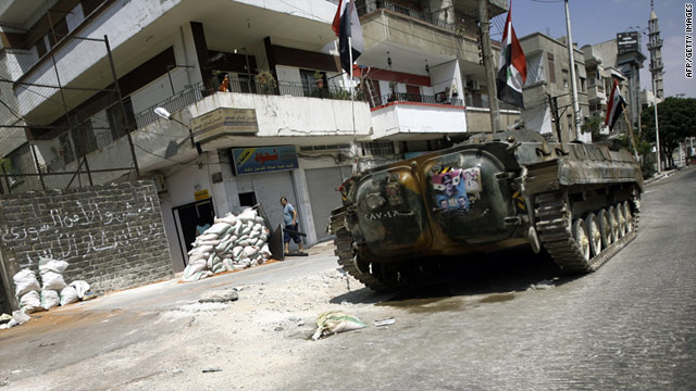A Syrian military tank takes up a position in a residential street in the flashpoint city of Homs on August 30, 2011.
