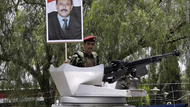 A Yemeni soldier holds up a picture of President Ali Abdullah Saleh during a rally in support of his regime on September 2, 2011.