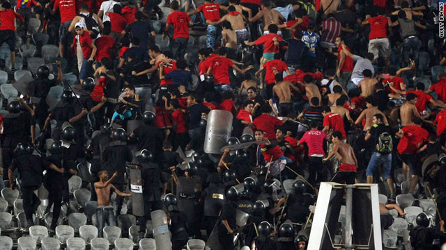 Police clash with al-Ahly supporters during their match against Kima Aswan in Cairo.