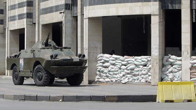 A Syrian armoured vehicle is pictured outside the police headquarters in the city of Homs on August 30, 2011.
