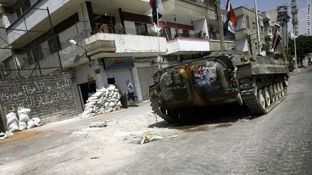 A Syrian military tank takes position in a residential street in the city of Homs on August 30, 2011.
