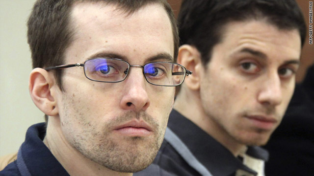 A picture released by Iran's state-run Press TV on February 6 shows Shane Bauer and Josh Fattal at their trial in Tehran.