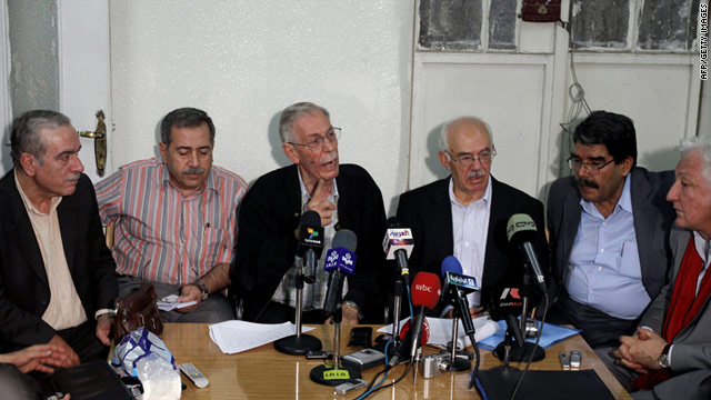 "Members of the National Coordinating Committee for Democratic Change hold a press conference in Damascus on Sunday. They called for the continuation of popular protests to overthrow the ""tyrannical"" regime in power in Syria."