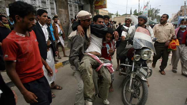 A Yemeni protester is injured following clashes with government troops outside Sanaa University on September 18, 2011.