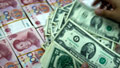 Best bet: U.S. dollar, or China's yuan?