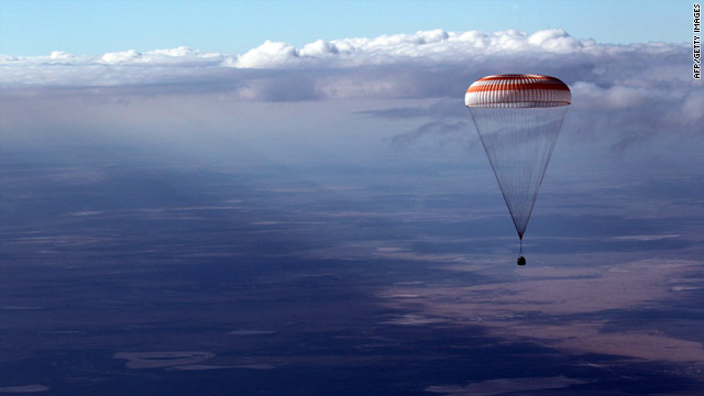 Astronauts return to earth