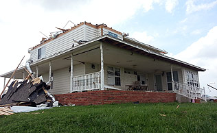 Melvin Sexton's home lost its roof in the storm.