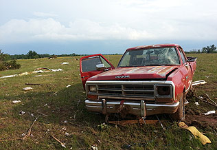 A truck was among the items damaged at the end of the tornado's route.