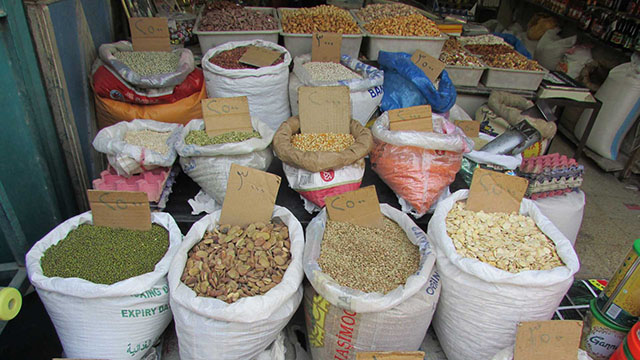 Dried beans and seeds are sold by the kilo at the Karrada market. Chickpeas and dried apricots are sold for 2,500 Iraqi Dinars, about $2, a kilo.