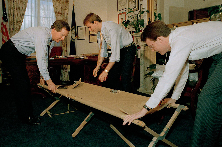 McConnell and aides Steve Johnson, center, and Mike Mitchell set up a cot in the senator's office in February 1988 preparing for another night of a Republican filibuster in the Senate over campaign spending legislation. Two years later, McConnell would beat back a strong challenge from Harvey Sloane, the Democratic mayor of Louisville. In what would become a theme in many of his races, McConnell tried to sway voters by talking up his clout in Washington and highlighting his close relationship with then-President George H.W. Bush. But McConnell changed his tune after Bush reneged on his
