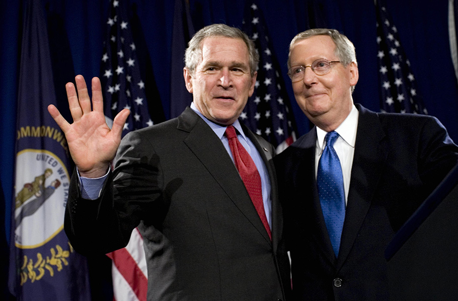 McConnell with then-President George W. Bush before a cheering crowd at a McConnell for Senate and National Republican Senatorial Committee Dinner in March 2007 in Louisville. McConnell would face a tough challenge the next year against Democrat Bruce Lunsford but survived with a 6-point win. McConnell promoted his clout in Washington, even running a television ad bragging about the billions in earmarks he secured for Kentucky, an unthinkable boast in today's Republican Party. (Brendan Smialowski/AFP/Getty Images)