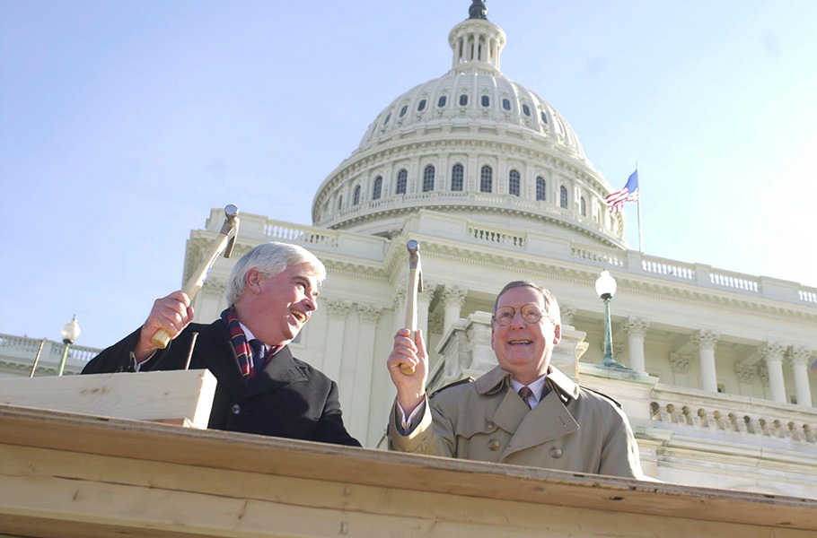 Sen. Chris Dodd, D-Connecticut, and McConnell, chairmen of the Joint Congressional Committee on Inaugural Ceremonies, drive the ceremonial 'first nail' into the 2001 Inaugural platform in front of the Capitol for George W. Bush's first inauguaration. McConnell would win his fourth term two years later against Lois Combs Weinberg, who McConnell painted as 'a member of the liberal elite,' tying her to then-Sens. Hillary Clinton and Ted Kennedy. McConnell won 65%-35%, the biggest winning margin of his political career.