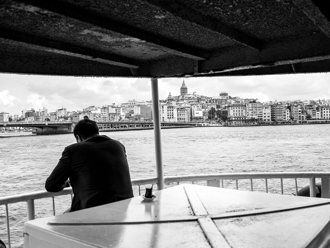 A man rides a ferry across the Bosphorus. Photographer Furkan Temir says many people tend to stay home in the immediate aftermath of terror attacks.