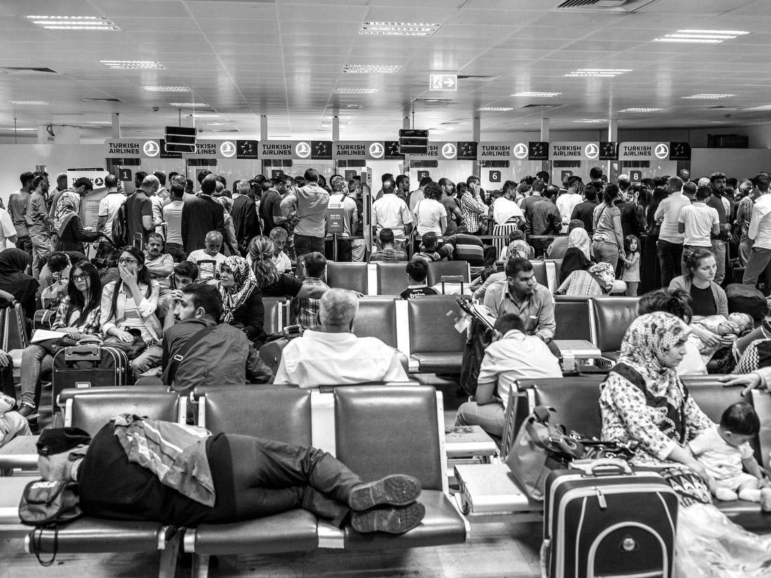 Passengers wait for their delayed flights.
