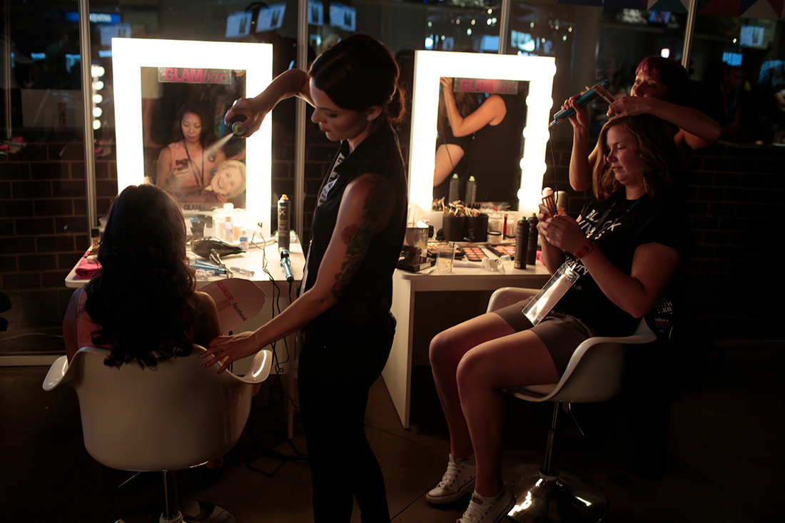 People get their hair done at a Democratic party hosted by Glamour magazine.
