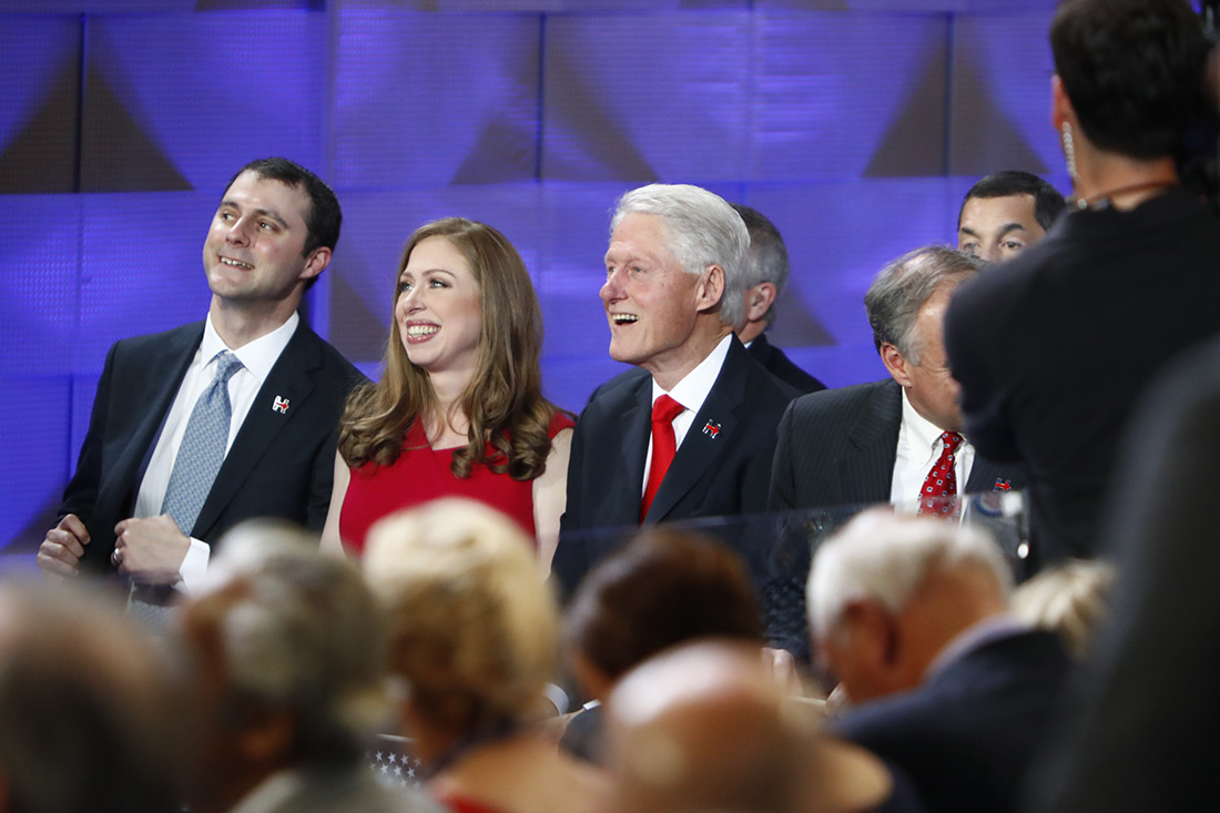 Clinton's family watches her speech.