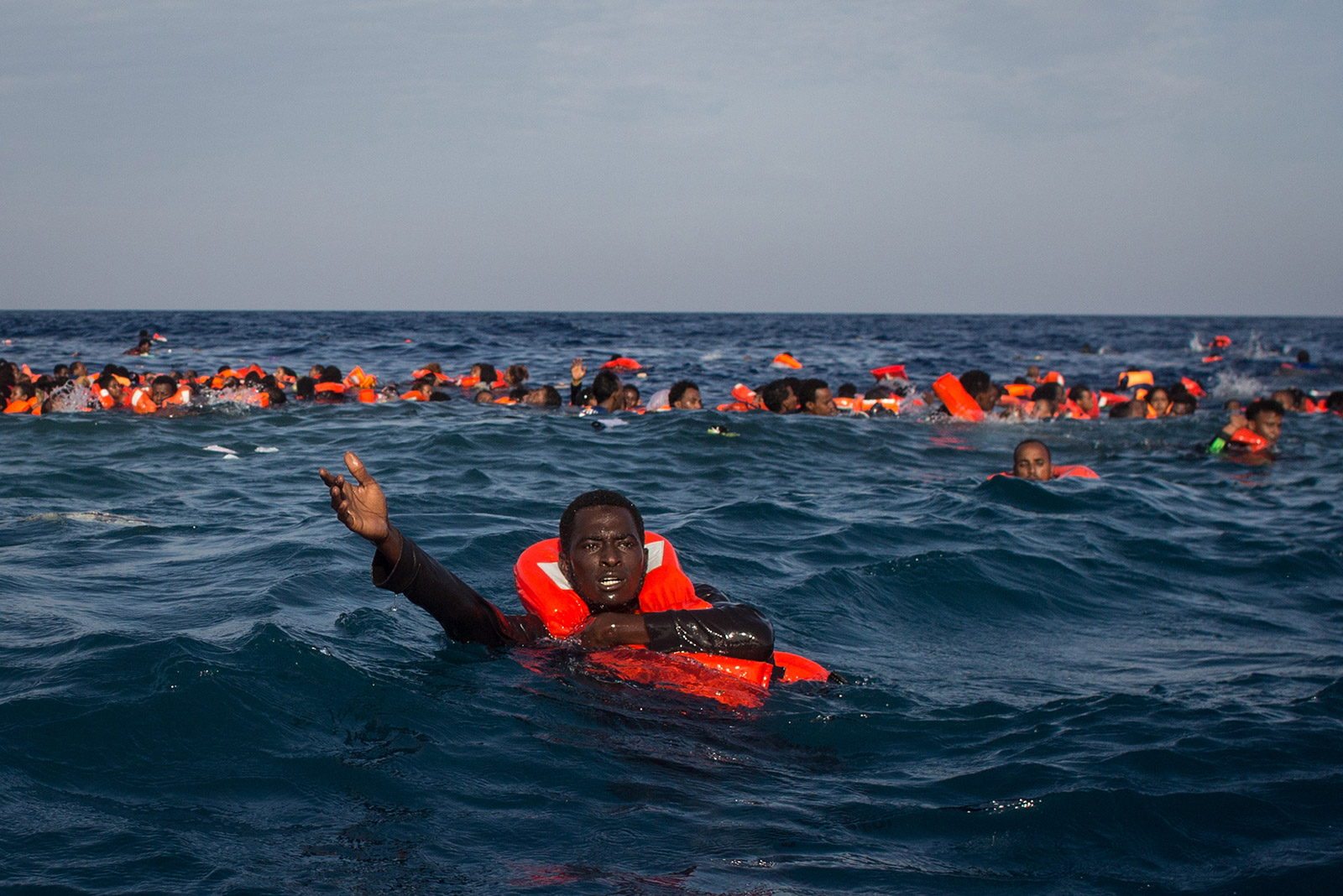ls-model 911 25 LAMPEDUSA, ITALY - MAY 24: Refugees and migrants are seen swimming and  yelling for