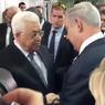 عباس وعريقات يصافحان نتنياهو خلال تشييع بيريز