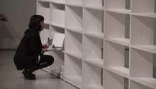 علب فارغة تبني مكتبة بغداد كتابا بكتاب