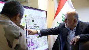 شاهد.. العبادي ملوحاً بالعلم العراقي في الفلوجة: سنرفعه في الموصل والحويجة
