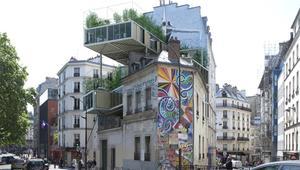 """مبان """"طفيلية"""" تجتاح باريس..من أين أتت؟"""