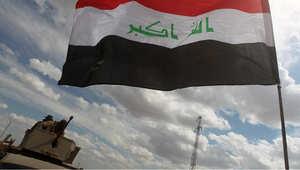 دورية للشرطة العراقية على أحد نقاط التفتيش على مدخل ناحية العلم القريبة من جبهة القتال في تكريت مع