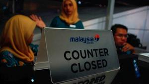 موظفون بالطيران الماليزي