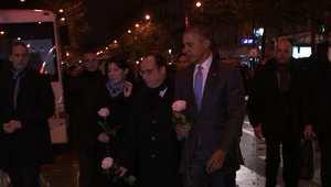 أوباما وهولاند يكرمان ضحايا باريس بورود بيضاء