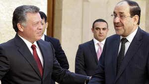 المالكي(يمين) خلال زيارة لعمان مع الملك عبد الله الثاني
